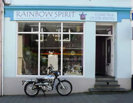 Graham's Royal Enfield parked outside Rainbow Spirit Crystal Shop